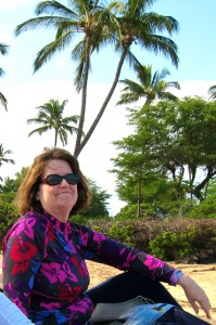 Deborah in her UPF 50+ Coolibar Ruched Swim Shirt